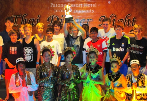Team is celebrating their trophy during a Thai Classical Dance Dinner